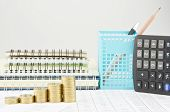 stock photo of piles  - Step pile of gold coins on finance account with pile of notebook as background - JPG