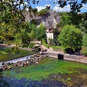 picture of century plant  - Beautiful Medieval Village Fontaine de Vaucluse on the river shore Provence France - JPG
