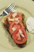 stock photo of cod  - Breaded cod fillet with tomato and onion with tartar sauce - JPG