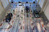 image of garage  - Cars entering a big parking garage at night - JPG