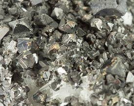 stock photo of ore lead  - Closeup macro picture of black lead ore irregular texture - JPG