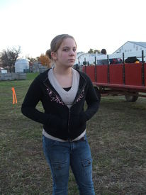 image of hayride  - young girl waiting to go on a hayride for halloween - JPG