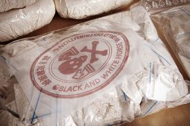 picture of smuggling  - Drug packages raw opium drug dozens and weapons seized by police - JPG