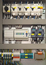 foto of electric station  - Electrical control cubicle with electrical devices closeup - JPG