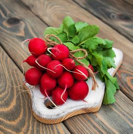 pic of radish  - Fresh organic radish on a old wooden background - JPG