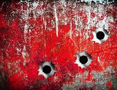 bullet holes in grunge metal plate
