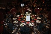 picture of black tie  - place setting all ready to go at a fundraising event held at night