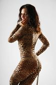 Woman Sneaking In Dappled Catsuit
