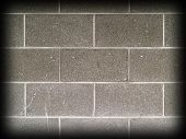 picture of cinder block  - Gray and white cinder block wall background with Dark Edge Border - JPG