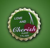 A photo of an love and cherish themed bottle cap