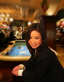 A photo of a woman about to throw the dice in a casino