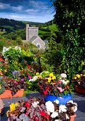 Colourful flowers provide setting for St Winifred's Church in the Devon