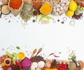 Постер, плакат: Spices And Herbs For Cooking Background And Design top View Spics And Herbs On White Background spic