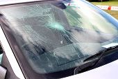 stock photo of car-window  - A Broken Car Windscreen at an Accident Site - JPG