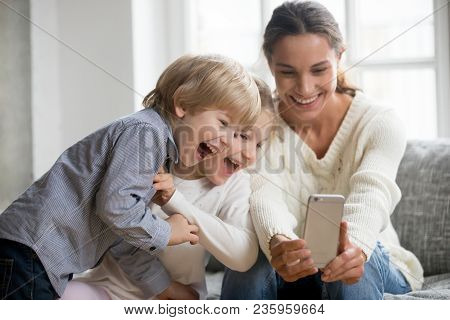 Smiling Mother Taking Selfie With