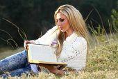 Blonde Lady Reading Bible