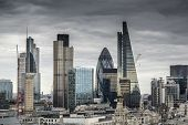 London Cityscape Skyline With Iconic Landmark Buildings In The City With Moody Stormy Sky poster