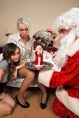 Playful Santa Claus make a present with allusion