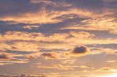 Sunset Sky Background. Dramatic Sunset Sky With Evening Sky Clouds Lit By Bright Sunlight - Natural  poster
