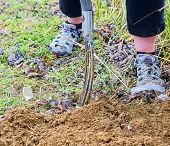 Woman Digging Soil With Garden Fork. Gardening And Hobby Concept. Gardening In The Spring. poster