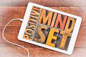 positive mindset word abstract in vintage letterpress wood type on a digital tablet poster