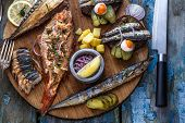 Fish Plate With Sturgeon, Trout, Perch, Mackerel. Assorted Fish On A Plate. poster