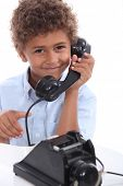 Young boy with an old-fashioned telephone