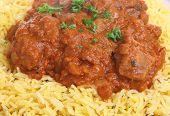 Lamb rogan josh Indian curry with pilau rice.