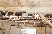 Damaged House Roof. Collapsed Roof Of The Total Damaged Domestic House Indoor From Natural Disaster  poster