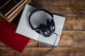 Books, Headphones, Outdoor Diary On A Wooden Background. The Concept Of Audio Books And Audio Traini poster