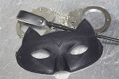 Mysterious Erotic Pleasure Things Concept. Cat Eye Mask, Whip And Hand Cuffs. Fetish Role Playing. poster