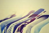Male Clothes, Jackets And Shirts Hanging On Clothes Rail. Blue Color Clothes. Copy Space. Image With poster