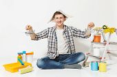 Happy Man In Newspaper Hat Holds Supermarket Metal Grocery Baskets For Shopping. Instruments For Ren poster