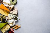 Assortment Of Hard, Semi-soft And Soft Cheeses With Olives, Grissini Bread Sticks, Capers, Grape, On poster