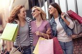 Young Attractive Girls With Shopping Bags In The City poster
