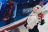 Elegant Business Muslim Arab Woman Near The Helicopter. Business, Success And Luxury Concept. Helico poster