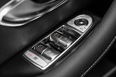 Close Up Of A Door Control Panel In A New Modern Car. Arm Rest With Window Control Panel, Door Lock  poster