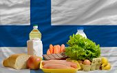 Basic Food Groceries In Front Of Finland National Flag