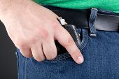 Man Pulling Gun Out Of Pocket