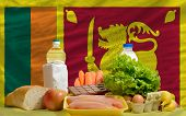 Basic Food Groceries In Front Of Sri Lanka National Flag