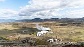 Geothermal Facilities In Iceland Geothermal Area With Boiling Mudpools And Steaming Fumaroles In Ice poster
