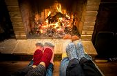 Mother Father And Kids Sitting At Cosy Fireplace On Christmas Time - Lovely Family Resting Together  poster