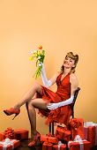 Flowers And Gift. Happy Girl With Gift&bouquet Of Tulips. Retro Woman With Present Box And Flowers.  poster