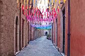 Colorful paper flags over street. Garland decoration at the fair. Decorations of colorful colorful f poster