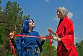 Young Woman And Man Cosplay