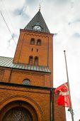 Aalborg, Denmark: Monastery Of The Virgin Mary And The Flag Of Denmark. Beautiful Catholic Church In poster