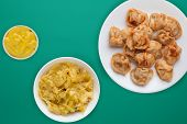 Dumplings On A White Plate Against A Green Background. Dumplings Meat In Tomato Sauce With Vegetable poster