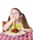 Beautiful Girl Eating Pasta And Meatballs With Hands