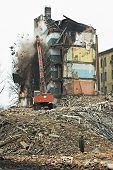 Destruction Of Old Apartment Buildings And Excavator