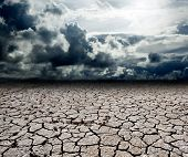 stock photo of drought  - Landscape with storm clouds and dry soil - JPG